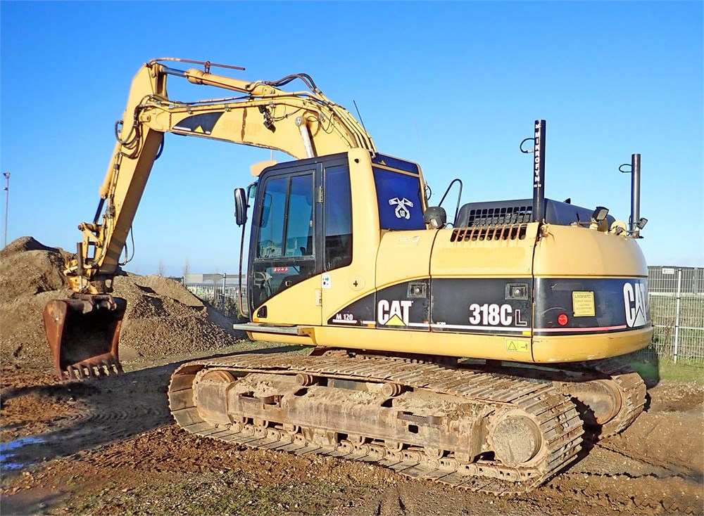 Caterpillar 318 CL, year 2005 - Fymas Auctions